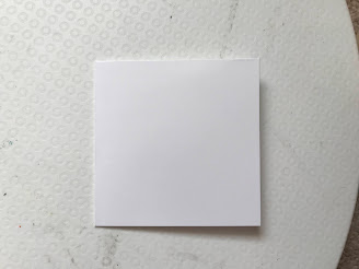 A white square card front