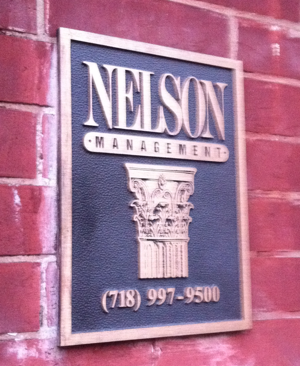 A Management Company Plaque On Building