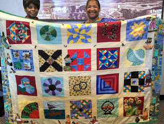 Sonya Hodges & Teresa Kemp with the last UGRR Quilt Code Quilt  made with her late mother it will be on exhibit at the Delta Arts Center Exhibit.