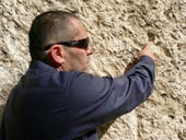 Simon pointing at the seal in the wall of the garden tomb