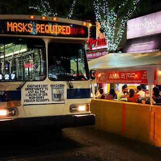 The Q49 bus in Jackson Heights rolls down 74th Street on a Friday night.