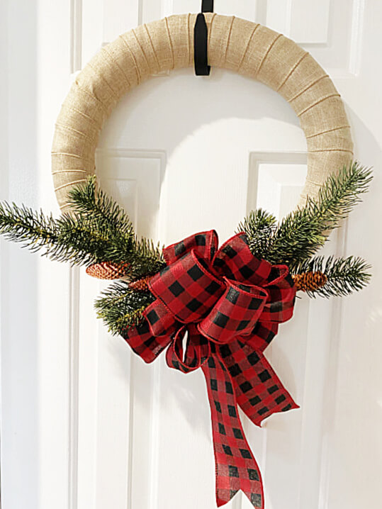 Finished wreath with greens and a buffalo checked bow