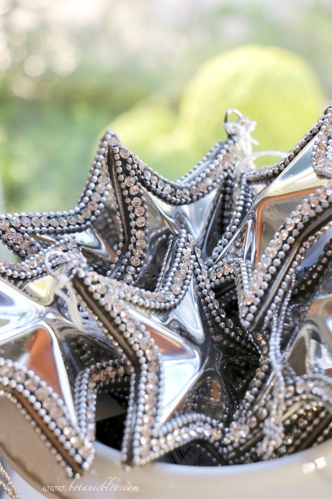 Silver metal stars with rhinestones are displayed in a white ceramic pot in this year's French Country Christmas Event