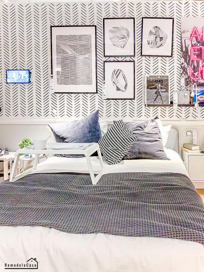 White bedroom with modern herringbone wallpaper