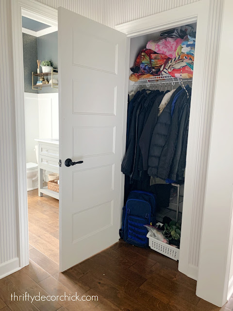 messy coat closet before