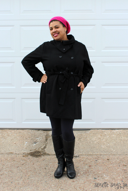 a woman in a black wool coat