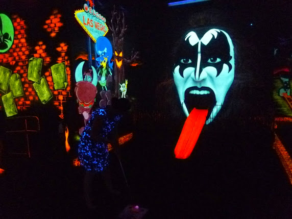 Emily putting into The Demon's mouth at KISS Monster Mini Golf in Las Vegas