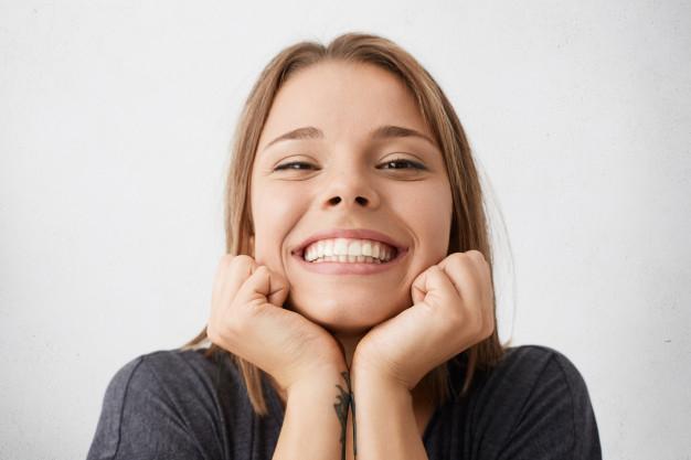 • Os benefícios de sorrir