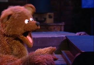 Baby bear plays the piano and he sings about learning alphabet. Sesame Street Do the Alphabet