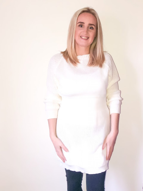 Close up of a white long sleeve jumper dress / Winter dresses from Femme Luxe