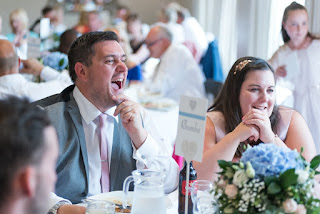 Wedding guests laughing at the speeches - Tickton Grange