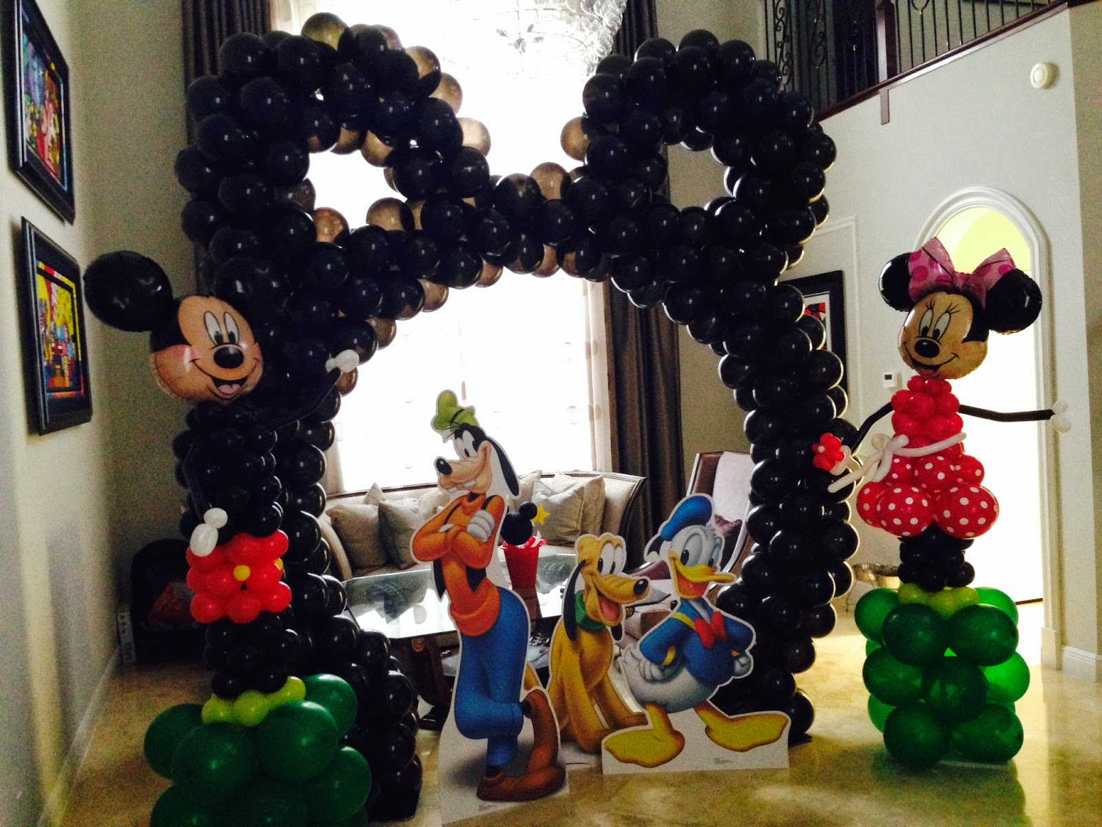 Mickey and Minnie character with balloons column