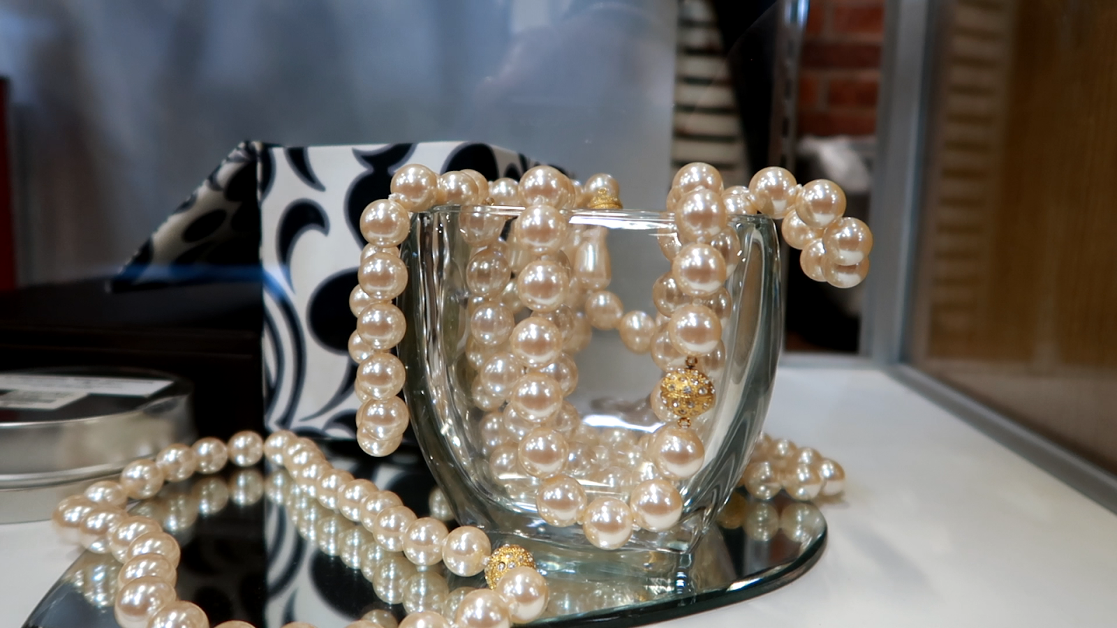 Image: Pearls hanging out a bucket at the thrift store