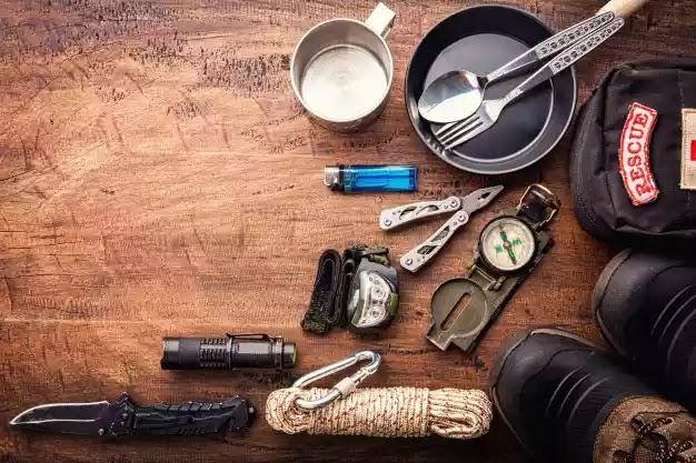 outdoor-travel-equipment-planning-mountain-trekking-camping-trip-wooden-background-top-view-vintage-film-grain-filter-effect-styles_130181-8 Freepik