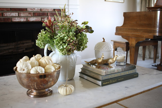 fall coffee table with white pumpkins hydrangeas acorn