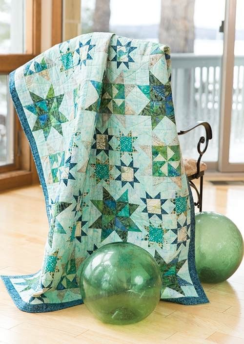 Stars In The Water Quilt designed by Nan Baker of Purrfect Spots for Timeless Treasures, features Tonga Surf collection