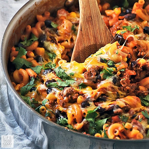 Serving cheesy one pot taco pasta skillet