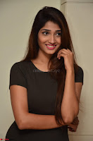 Priya Vadlamani super cute in tight brown dress at Stone Media Films production No 1 movie announcement 014.jpg