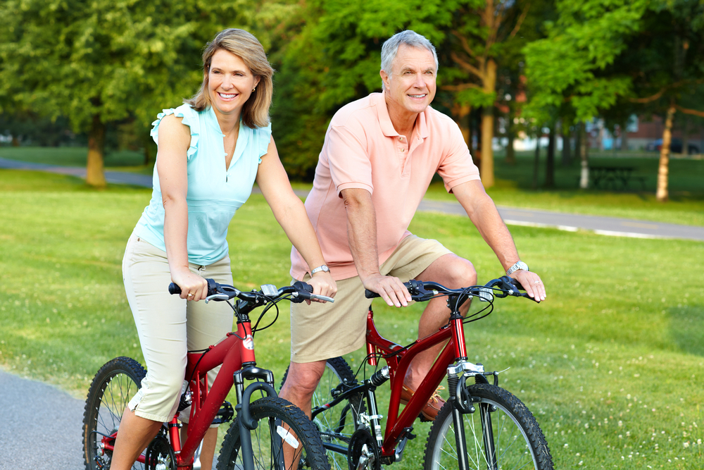 Happy couple out for a bike ride