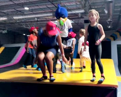 Yo-Jelly mascot with children dancing at Bounce Inc