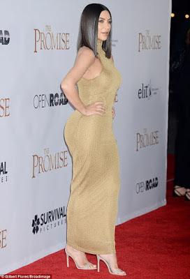 Sexy Kim Kardashian stuns in skintight Gold dress at The Promise premiere
