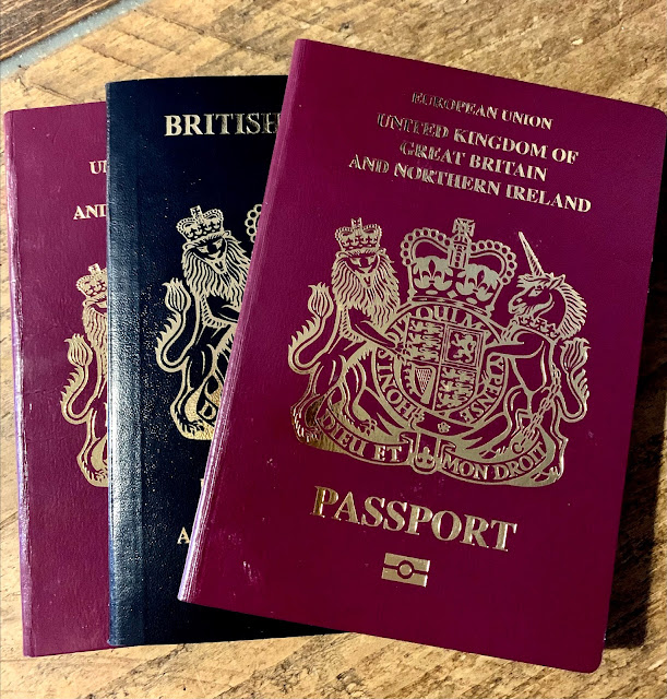red and blue British passports