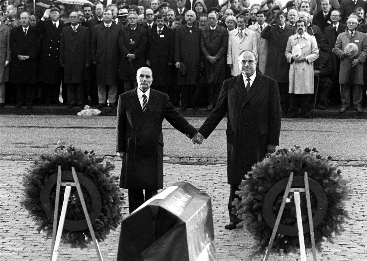 French President François Mitterrand and German Chancellor Helmut Kohl in 1984 at Douaumont cemetery.