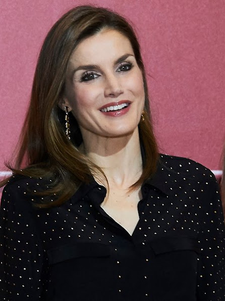 Queen Letizia wore Uterque Blouse, carried Nina Ricci Arc Clutch, Magrit Shoes, Tous Jewelers Earrings, wore Boss Trousers