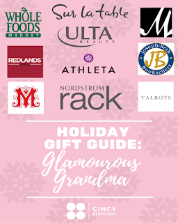 Pink background with pink snowflakes, reads Holiday Gift Guide for Glamorous Grandma, with logos of Rookwood Stores