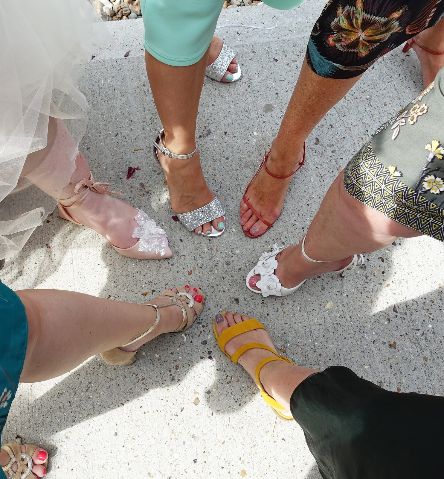 Some of the sandals and shoes worn by wedding guests at an English seaside wedding, August 2018