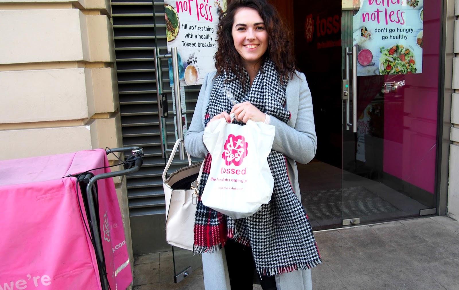 Girl standing outside shop