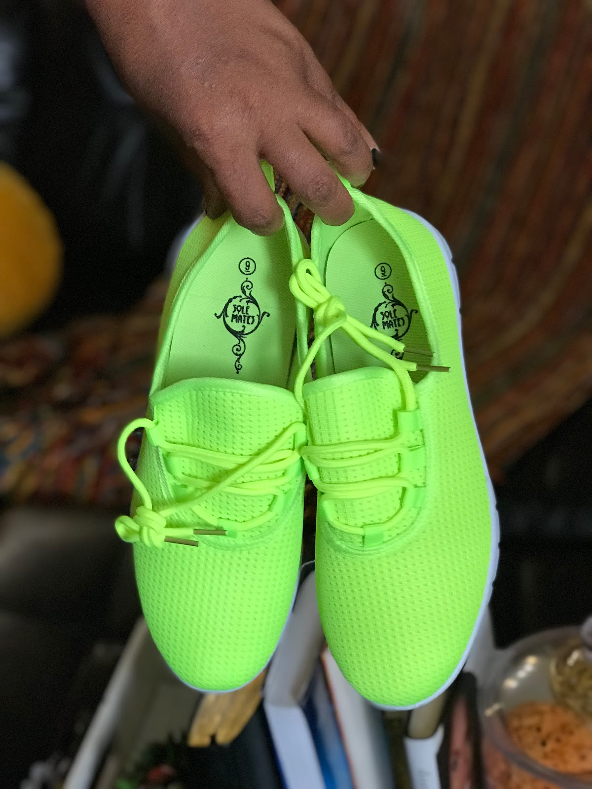 Image: Neon shoes Tangie Bell bought at a sale