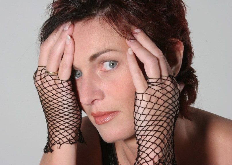 Skeptical beauty with fishnet gloves and hands to her face pixabay image
