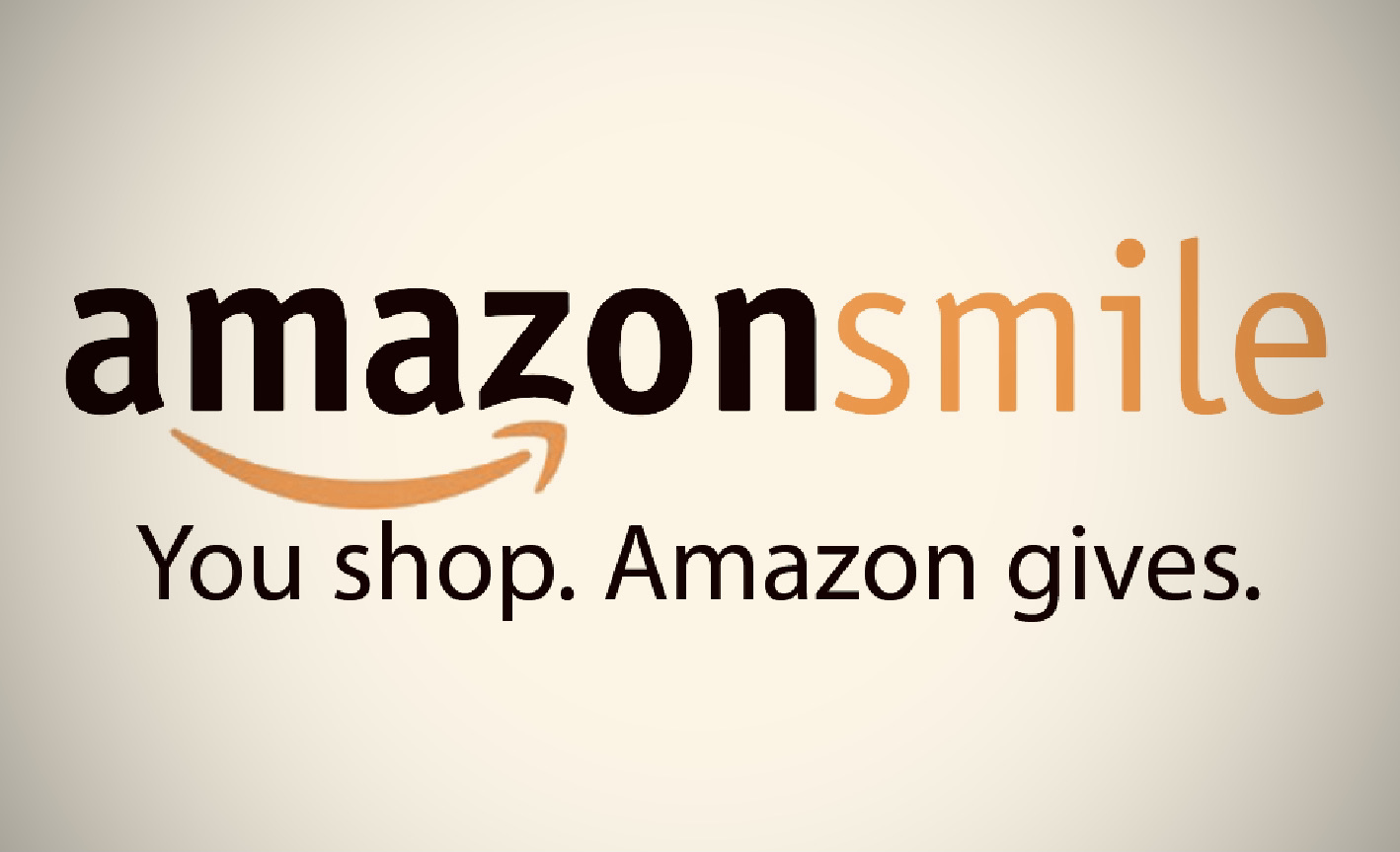 "Amazon Smile Charity Banner 1. White Background with Black and Orange Text reading ""Amazon Smile. You shop, Amazon gives."""