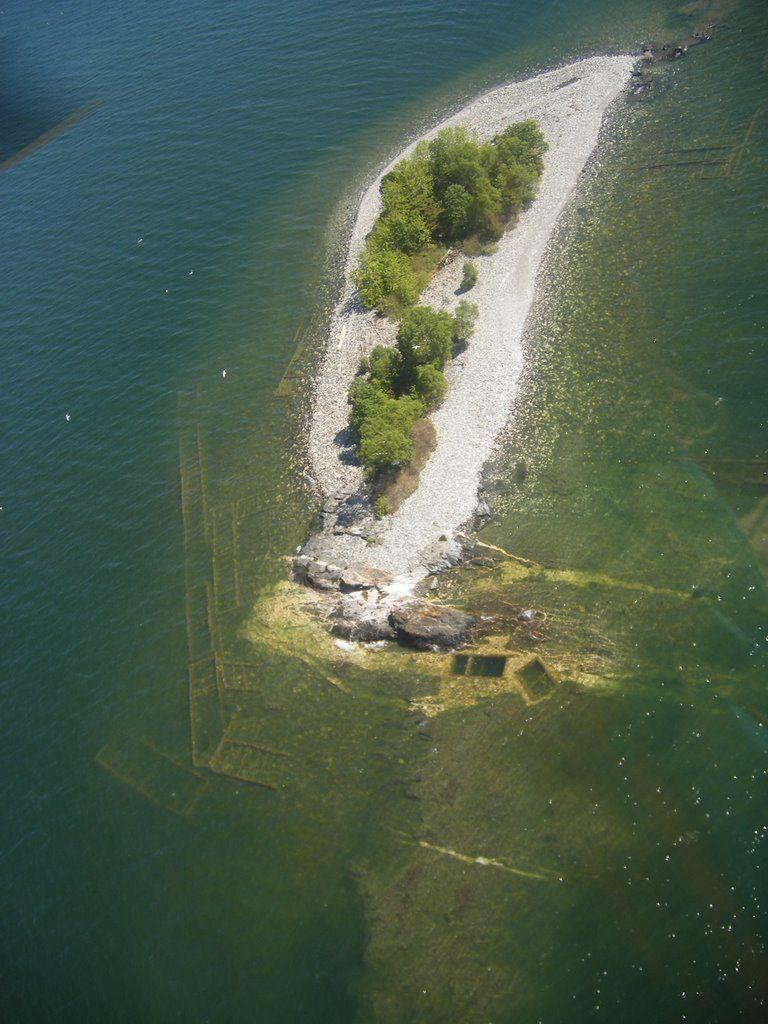 Горнодобывающая компания использовала щебень, чтобы расширить Серебряный островок более чем в десять раз.
