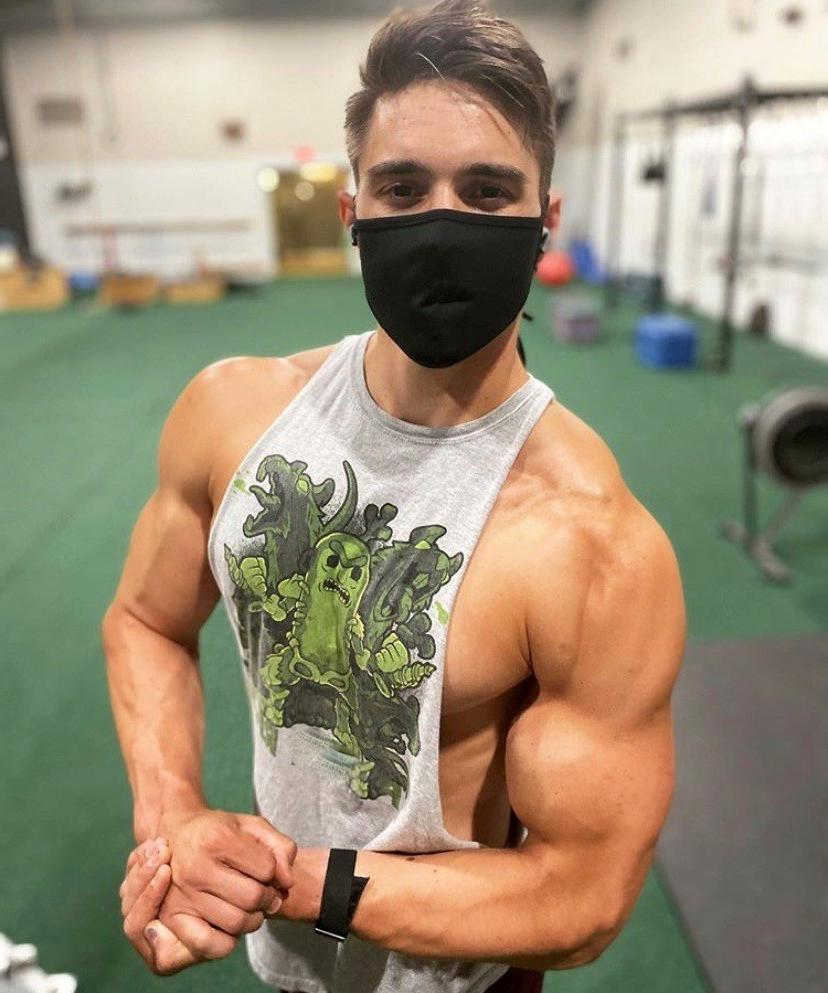 young-handsome-gym-hunk-biceps-flex-face-mask