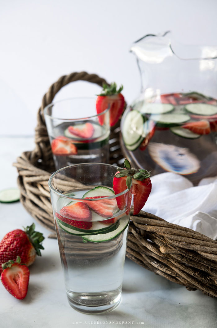 Glass of strawberry water in front of tray