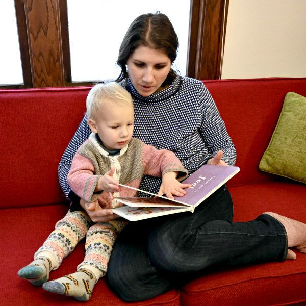 Ioana Stoian reading her new board book, Always Be You,  to her toddler son at home