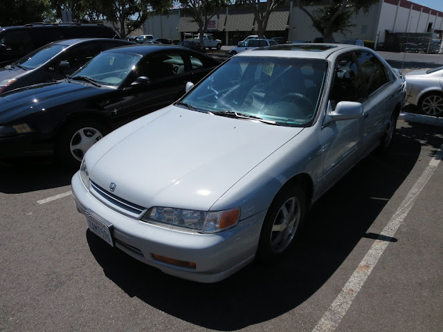 Honda Accord after overall paint job with color change and headlamp restoration.