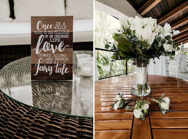 Detail shot of flower centerpiece and farmhouse wood plank The Manor on St Lucie Crescent Wedding captured by Stuart Wedding Photographer Heather Houghton Photography