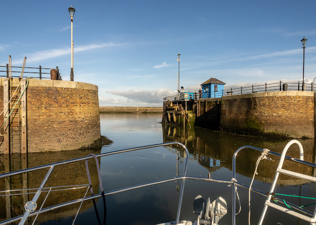 Photo of Ravensdale going out of the marina gate in glorious sunshine