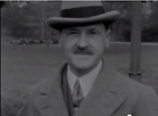 still of W. Somerset Maugham as Monsieur Duval in Ralph Barton's Camille (1926)