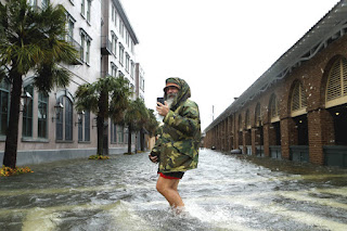Rising sea levels increase the risk of storm surge flooding in coastal cities like Charleston, South Carolina, shown here after Hurricane Matthew. (Credit: Brian Blanco/Getty Images) Click to Enlarge.