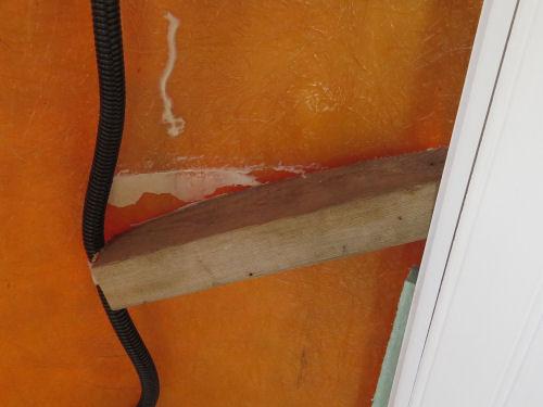wood brace pulled loose from fiberglass wall