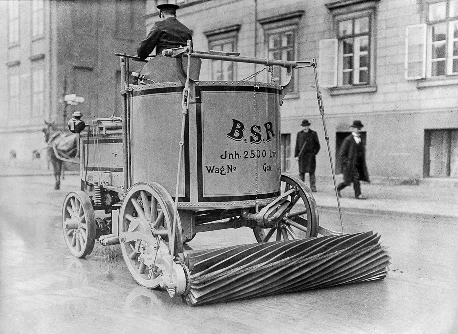 An electric street sweeper cleans the roadway in Berlin, Germany. 1907.