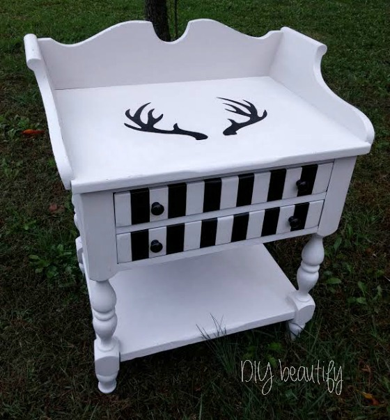 Painted Table makeover with bold stripes and antlers ~ see tips and tutorial at www.diybeautify.com