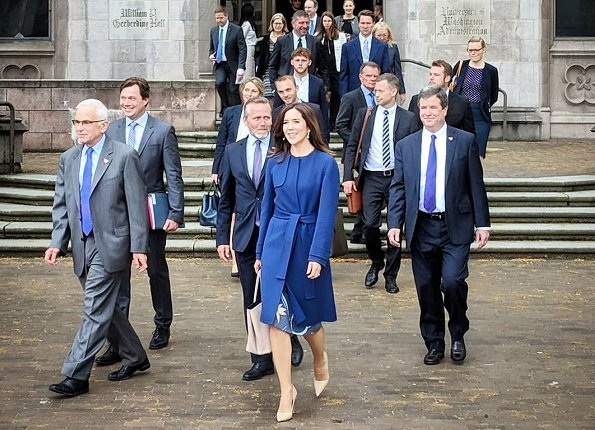 Crown Princess Mary wore Prada nude pointed toe pump, carried Prada Saffiano Cuir Double Bag, By Malene Birger blue belted wool-blend coat and print dress