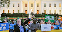 Gene Karpinski (left with microphone), president of the League of Conversation Voters, speaks during a gathering in front of the White House to celebrate President Obama's rejection of the Keystone XL pipeline last year. (Photo Credit: AP Images.) Click to Enlarge.