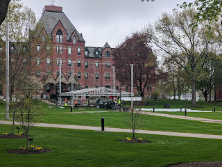 setting up for commencement in the rain on Wednesday