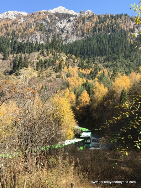 shuttle bus winds through Jiuzhaigou Valley National Park in Sichuan Province, China